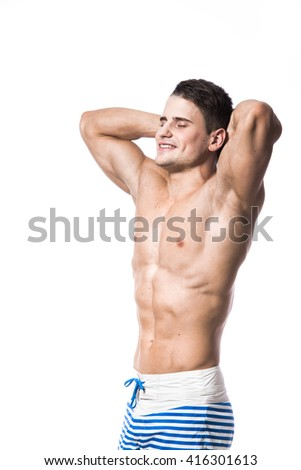 Portrait of a handsome young muscular man in swimwear with hands folded over his head isolated looking up eyes closed on white background - stock photo