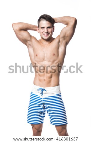 Portrait of a handsome young muscular man in swimwear with hands folded over his head isolated on white background - stock photo