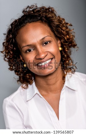 Portrait of a happy African American woman smiling - stock photo