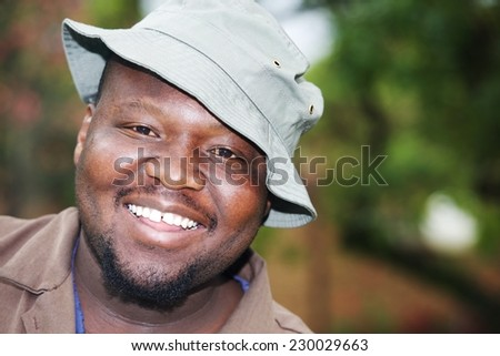 Portrait of a happy African gardener with hat - stock photo
