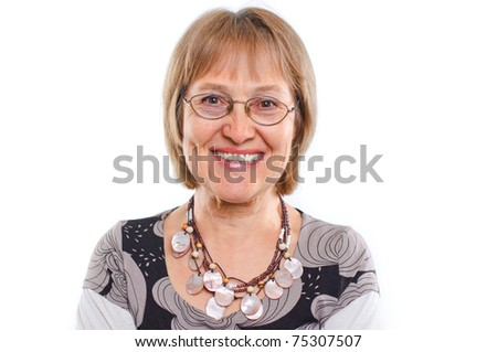 Portrait of a happy aged woman smiling - stock photo