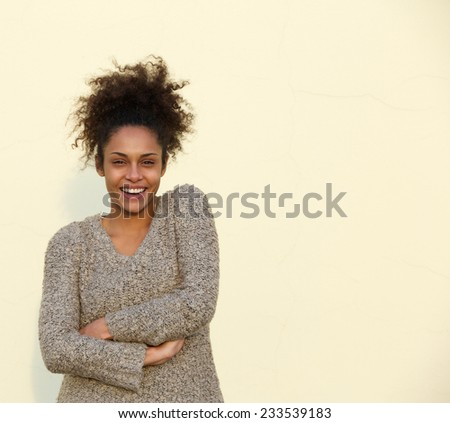 Portrait of a happy and confident african american woman smiling  - stock photo