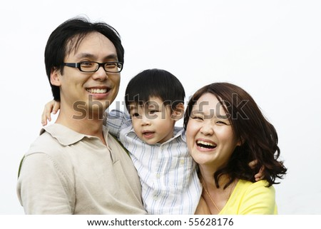 Portrait of a happy Asian family - stock photo