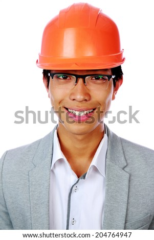 Portrait of a happy asian man in helmet over white background - stock photo