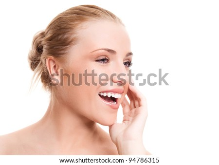 portrait of a happy beautiful laughing woman touching her cheek, isolated against white background - stock photo