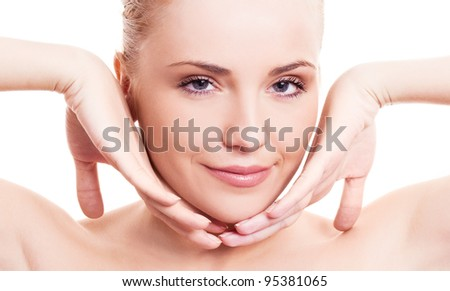 portrait of a happy beautiful smiling woman touching her face, isolated against white background - stock photo