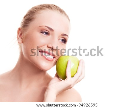 portrait of a happy beautiful woman  holding an apple, isolated against white background - stock photo