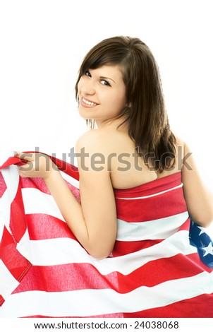 portrait of a happy beautiful young nude woman wrapped into the American flag - stock photo