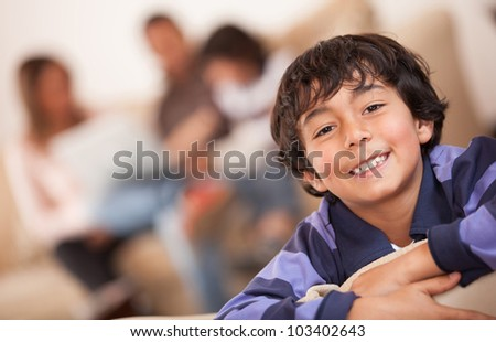 Portrait of a happy boy smiling - indoors - stock photo