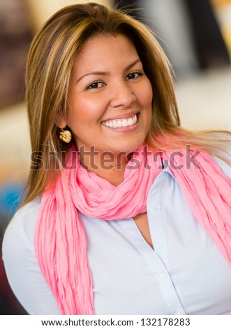 Portrait of a happy casual woman smiling - stock photo