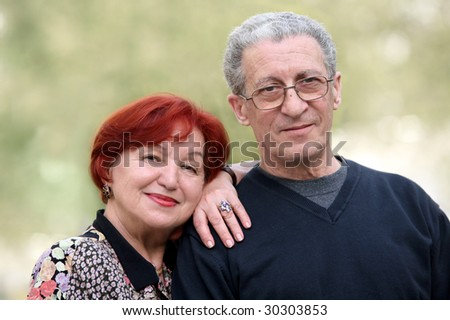 Portrait of a happy couple in their seventies - stock photo