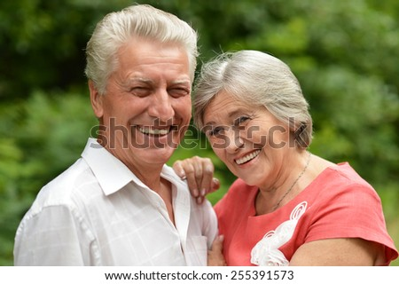 Portrait of a happy elder couple in summer - stock photo