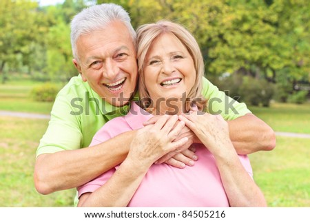 Portrait of a happy elderly couple outdoors. - stock photo