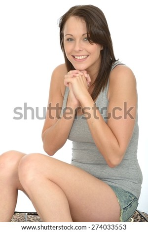 Portrait of a Happy Excited Dark Haired Attractive Young Woman in Her Twenties Smiling and Laughing - stock photo