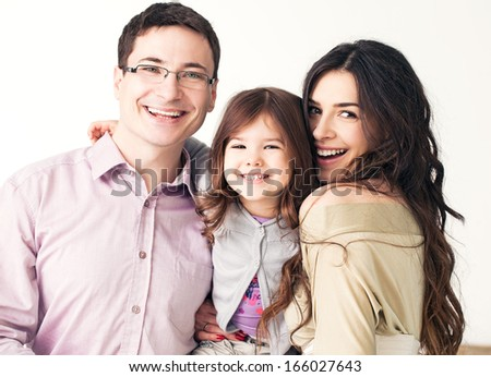 Portrait of a happy family against a back background. - stock photo