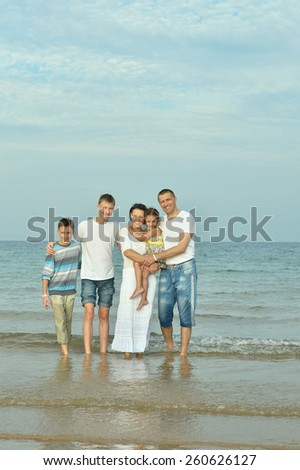 Portrait of a happy family at beach in summer - stock photo