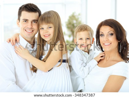 portrait of a happy family. children in the hands of the parents - stock photo
