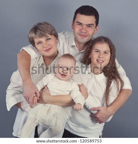 Portrait of a happy family, indoor - stock photo