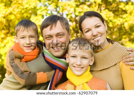 portrait of a happy family  on the nature - stock photo