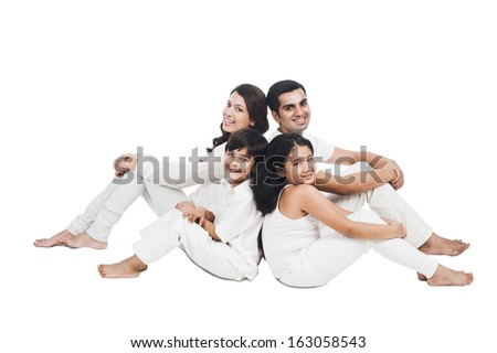 Portrait of a happy family sitting together - stock photo