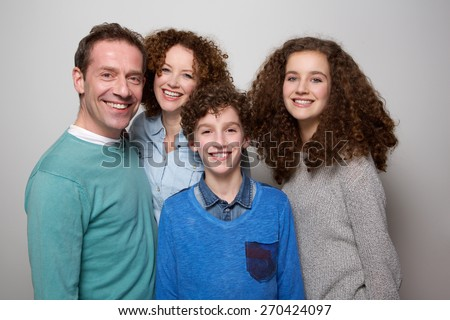Portrait of a happy family smiling together - stock photo