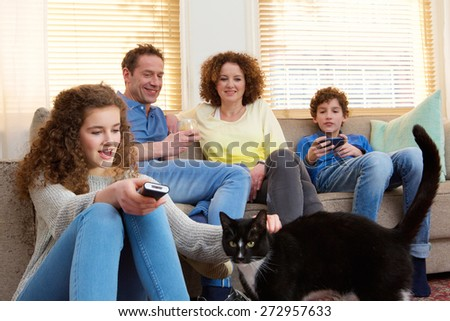 Portrait of a happy family with house pet relaxing at home - stock photo