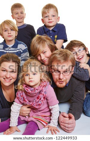 Portrait of a happy family with many children - stock photo