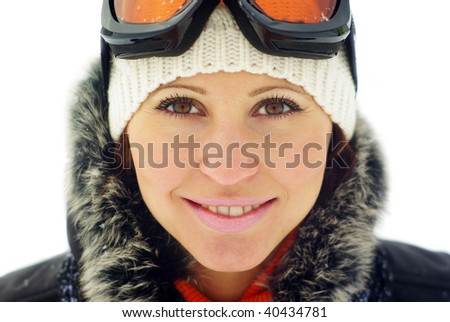 Portrait of a happy female skier isolated over white background - stock photo