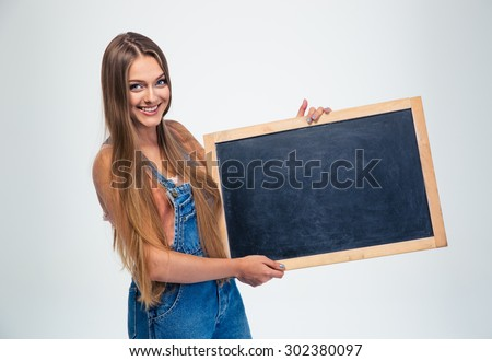 Portrait of a happy female student holding blank board isolated on a white background - stock photo