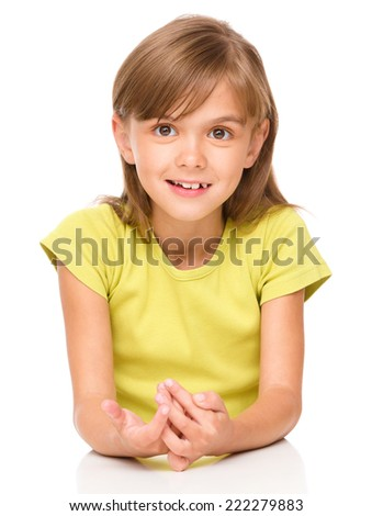Portrait of a happy little girl laughing, isolated over white - stock photo