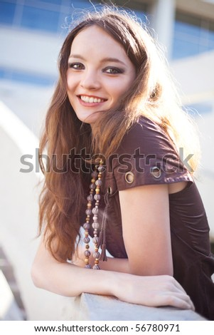 portrait of a happy lovely young laughing girl wearing beads - stock photo