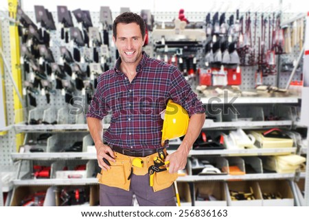 Portrait Of A Happy Male Technician With Tools - stock photo