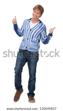 Portrait of a happy man showing thumbs up sign - stock photo