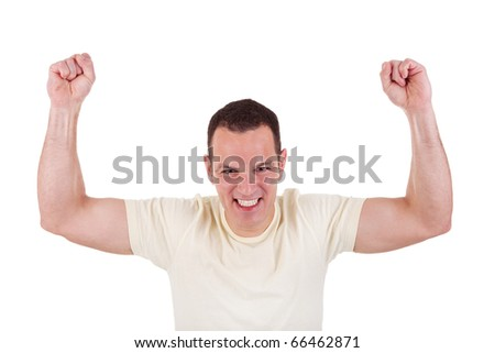 Portrait of a happy  man with his arms raised, on white background. Studio shot - stock photo
