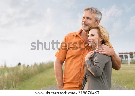 Portrait Of A Happy Mature Man Embracing Her Wife and Contemplate The Future - stock photo