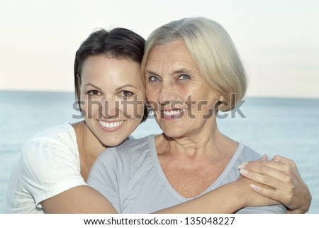 portrait of a happy middle-aged and young women on vacation - stock photo