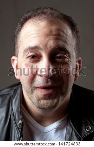 Portrait of a happy middle aged Italian man. - stock photo