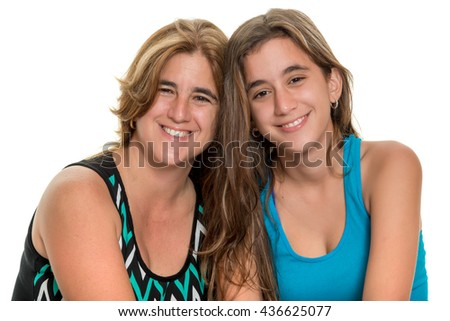 Portrait of a happy mother and her teenage daughter - Isolated on white - stock photo