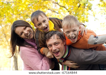 portrait of a happy nice family on the nature - stock photo