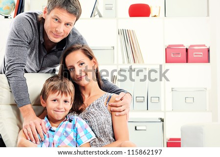 Portrait of a happy parents with their son together at home. - stock photo