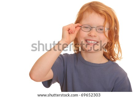 Portrait of a happy red haired girl wearing glasses - stock photo