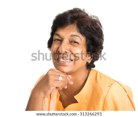 Portrait of a happy 50s Indian mature woman smiling, isolated on white background. - stock photo