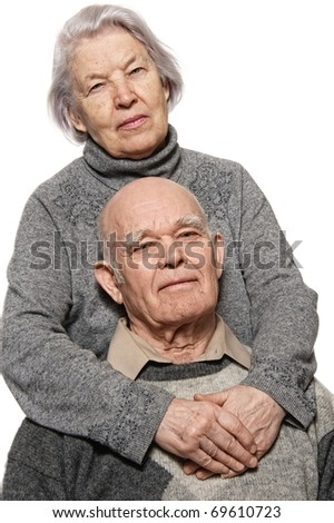 Portrait of a happy senior couple embracing each other - stock photo