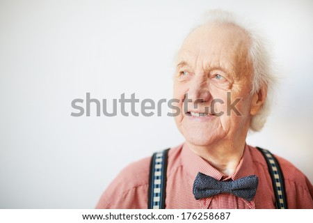 Portrait of a happy senior well-dressed man in isolation - stock photo