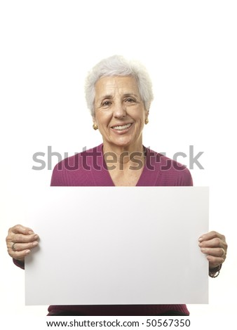 Portrait of a happy senior woman holding blank billboard against white background - stock photo