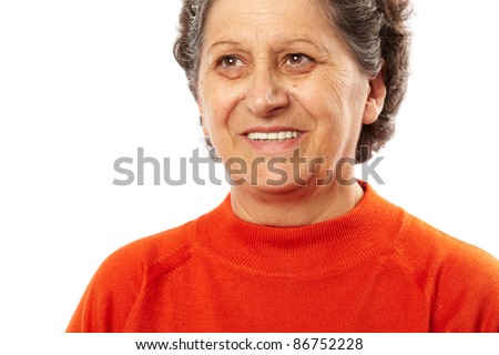 Portrait of a happy senior woman isolated on white background - stock photo