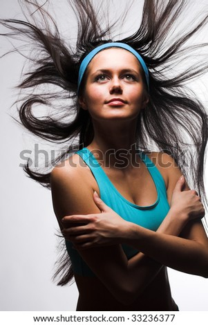 Portrait of a happy sporty woman  isolated over white background - stock photo
