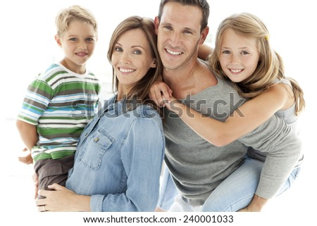 Portrait of a happy standard Caucasian family - stock photo