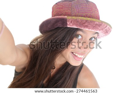 portrait of a happy teen girl taking a self portrait on a white background - stock photo