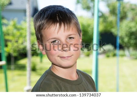 portrait of a happy teenager in the garden - stock photo